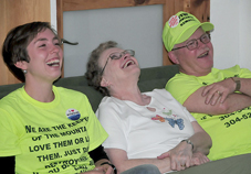 Larry Gibson, his wife Carol, and Tricia Feeney laugh at one of the speakers during the Earth Day fundraising event