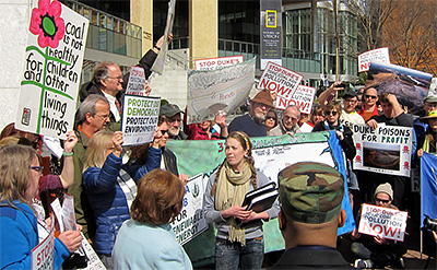 Citizens deliver 9000 petition signatures asking Duke to clean up the coal ash spill