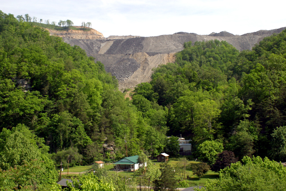 A community in Wise County, Virginia sits at the base of a mountaintop removal coal mine. Photo by Jamie Goodman