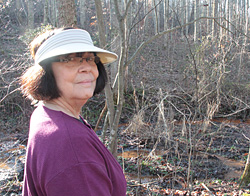 Kathy Selvage surveys orange water near her Virginia home.