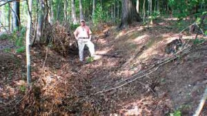 A remnant section of Gunter's Landing trail near Wills Town Alabama used by 1100 Cherokee Indians in the Trail of Tears 1838. Rick West stands in the road for scale. Photo by Lamar Marshall