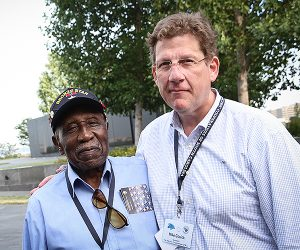 Mike Couick, right, pauses with a WWII veteran during an event sponsored by the electric cooperatives. Photo by Luis Gomez