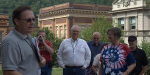 Doug Estepp, left, discusses the assassination of Sid Hatfield with a tour group. Photo by Klair Gaston