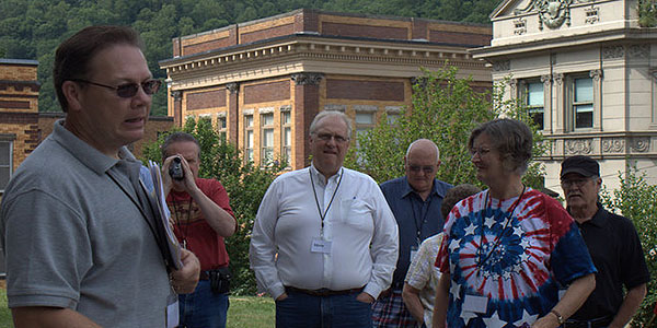 Doug Estepp, left, discusses the assassination of Sid Hatfield with a tour group. Photo by Klair Gaston