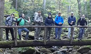Freelance writer Davis Wax, second from left, pauses with the Rocky Top Trail Crew on the Snake Den Ridge Trail. Photo by Kayah Gaydish
