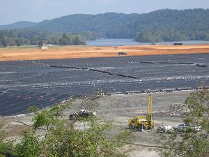 The black liner covering the coal ash containment cell, above, will be topped with two feet of soil and grass when the Tennessee site is converted to a park. Photo by Cat McCue.