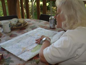 With a map of the Cumberland Gap spread on the table, Sylvia Ray, mother of Tammy Stachowicz, researches the residences of her Melungeon ancestors.