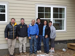 Future homeowners, volunteers and experts help build these energy-efficient homes. Photo by Alex Hooker