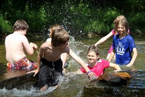 Children splash in North Carolina's Watauga River