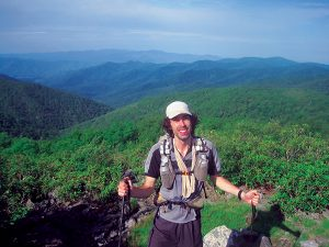 Matt Kirk stands at Rocky Top on the Appalachian Trail while thru hiking SALT. Photo courtesy Matt Kirk