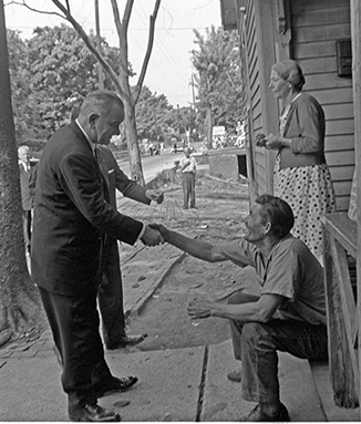 During his official poverty tour in 1964, President Lyndon B. Johnson shook the hand of a resident in an undisclosed part of Appalachia. Photo courtesy LBJ Library, by Cecil Stoughton