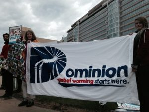 Activists and shareholders concerned with Dominion's negligence on climate change converged on the utility's annual meeting yesterday. Photo by Chesapeake Climate Action Network.