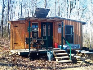"Scott Goebel refers to the Elmo's Haven retreat as a ""cabin at the end of the whirled."""