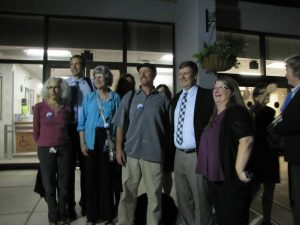 Members of Gainesville Loves Mountains and Appalachian Voices' staff celebrate with commissioner Lauren Poe after the vote.