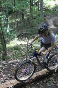 A rider bikes along the Sugar Maple Trail