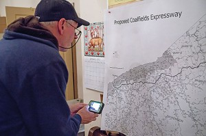 A resident looks at a map of the proposed Coalfields Expressway during a community forum. Photo by Alistair Burke, alistairburkephotography.com