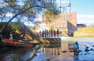 Guilford College students in front of the retired Dan River Steam Station during a river outing with the Dan River Basin Association in 2013. The association has long promoted citizen water quality testing as a vital component of healthy waterways. Photo by Brian Williams