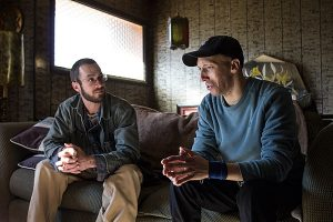 In his home, Zach Dixon, right, talks with Rory McIlmoil of Appalachian Voices about his high heating bills. Photo by Jaimie McGirt