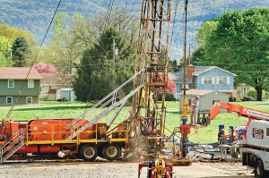 The minimum required distance between gas wells and homes allows for construction at close quarters with neighboring residents. Courtesy of Terry Wild Stock Photography.