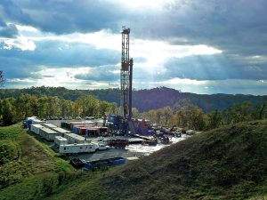 A gas drilling rig was built on David Wentz's land in Doddridge County, W. Va., without his permission, a legal phenomenon that is increasingly widespread in areas such as the Marcellus shale region. Photo by Diane Pitcock, <a href=