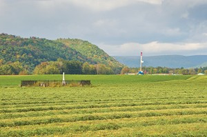 A natural gas drilling rig in Loyalsock Creek Valley, Pa., sits near a family cemetery and Baptist church. Photo courtesy of Terry Wild Stock Photography.