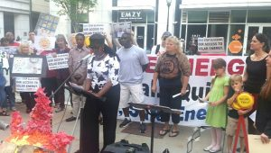 Residents impacted by coal ash join together with concerned citizens to rally outside the annual Duke Energy shareholder's meeting in Charlotte on May 7. Photo courtesy of NC WARN