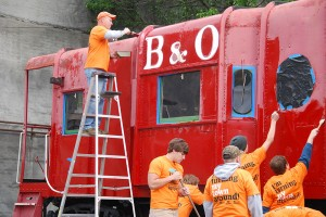 Community members participating in the Grafton, W. Va., Turn This Town Around initiative completed projects such as repainting a downtown caboose. Photo courtesy of Amanda Yager, WV Community Development Hub