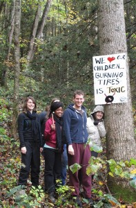 Park University students post signs at Cranks Creek Lake in Kentucky, warning about the hazards of burning tires. Photo by Dave Cooper