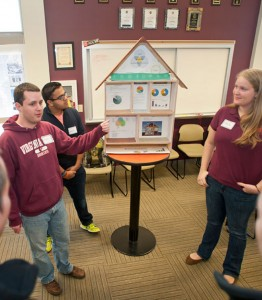 Virginia Tech students explain sustainable building practices to high school students. Photo courtesy of Virginia Tech