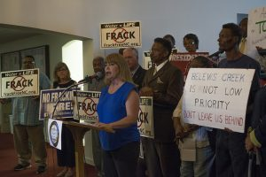 Local citizens rally against injustice as Appalachian Voices' N.C. Campaign Coordinator Amy Adams addresses the crowd.