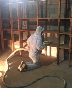 "Smith Insulation contractors install spray foam in Woolery's basement. ""Last year, two new [regional contracting] businesses entered the spray foam industry,"" says Woolery. ""There's a lot of demand for this type of work."" Photo by Chris Woolery"