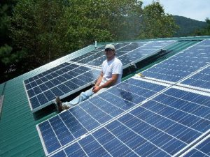 John Parker, an electrician who founded Parker Electric, donated his time to install solar panels on both Ashe County Habitat for Humanity's houses.