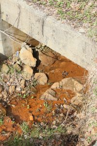 Acid mine drainage flows from a mountaintop removal coal mine into Looney Creek in Wise County, Va.