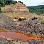 Acid mine drainage collects at the KD #2 mine site shortly after the state halted work at the mine. Photo courtesy the Kanawha Forest Coalition