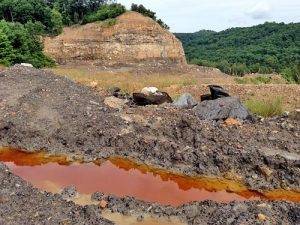 Acid mine drainage collects at the KD #2 mine site shortly after the state halted work at the mine. A recent inspection recorded pH values between 3 and 4, which is 100 to 1,000 times more acidic than allowed by law. Photo courtesy the Kanawha Forest Coalition