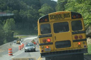 Buses transporting students to and from Ridgeview High School on Route 83 must contend with a steep descent and frequently clogged roadway. Photo by Molly Moore