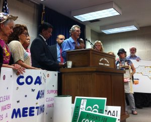 Larry Mathis of Belmont, N.C., represents a new statewide coalition of residents affected by coal ash at a September press conference in Raleigh. Rep. Charles Graham of Lumberton, N.C., sponsored the press conference on behalf of Alliance of Carolinians Together (ACT) Against Coal Ash. Photo by Marie Garlock