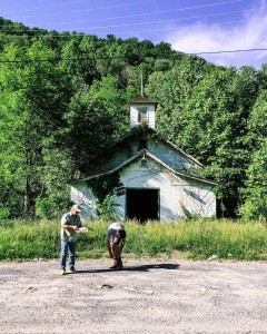 Photographer Brady Darragh and activist Chuck Nelson stand outside the abandoned union hall in Lindytown, W.Va. Lindytown's population, like that of Coalville, was displaced by the mining industry.