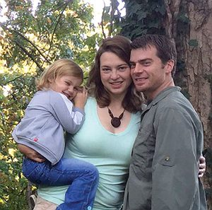 Amy Kelly (center) with husband Lyle and daughter Aidia.