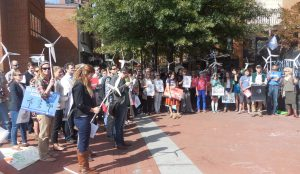 Concerned citizens and clean energy advocates gather on the downtown mall in Charlottesville for a National Day of Climate Action.