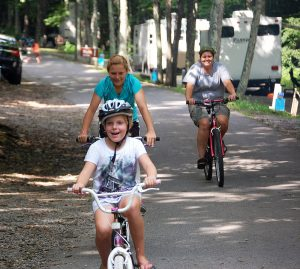 A family bikes at Grayson Highlands State Park campground, near the popular 34-mile Virginia Creeper Trail. Photo courtesy Virginia State Parks