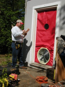 Energy auditor evaluates a home. Image courtesy of City of Knoxville Office of Sustainability and Knoxville-Knox County Community Action Committee Housing & Energy