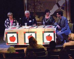 A panel discusses strategies for regenerating coalfield communities in Appalachia and Wales at a 2014 community forum held at the Appalshop building in Whitesburg, Ky. From left to right: Mair Francis, founder of DOVE Workshop, Hywel Francis, then a member of Parliament, Robin Gabbard of the Foundation for Appalachian Kentucky, and Evan Smith of the Appalachian Citizens Law Center. Photo by Angela Wiley.