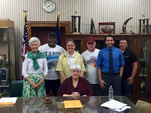 Local residents and members of Kentuckians For The Commonwealth stand with the Benham City Council in eastern Kentucky after a unanimous vote to pass a resolution supporting the Power-Plus Plan in August.  Photo courtesy Appalachian Citizens' Law Center