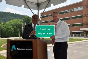 "Why would a bankruptcy judge approve a bonus plan for a bankrupt coal company that was ""written almost entirely by the executives who hope to exact almost $12 million of profit from it?"" Photo of West Virginia Gov. Early Ray Tomblin and Alpha CEO Kevin Crutchfield via Flickr"