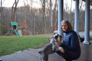 Jill Averitt and her dog, Cliff, enjoy a moment outdoors. The Atlantic Coast Pipeline would cut through her land, along the hillside just beyond the swing set. Photo by Cat McCue