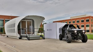 The 3D-printed home and vehicle sit on display at Oak Ridge National Laboratory in East Tennessee.