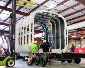Workers assemble the building with components printed on-site. Photos courtesy of ORNL