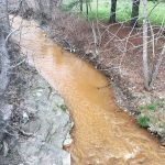 Acid mine drainage from a coal mine flooded into Pine Creek in eastern Kentucky, killing wildlife and raising concerns over drinking water safety. Photo by Tarence Ray