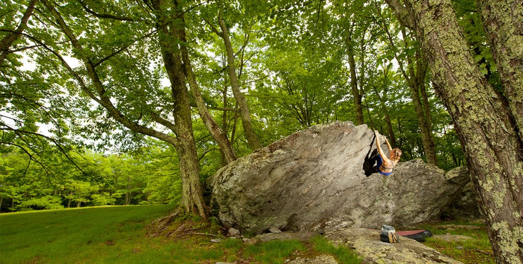 "Julia Statler completes a challenging climb called ""Wall Street"" in the Picnic Area of Grayson Highlands. Photo by Dan Brayack"